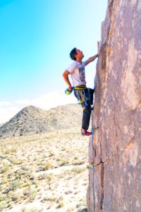 Climbing a sheer rock face